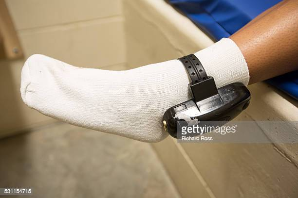 Teen showing ankle monitor