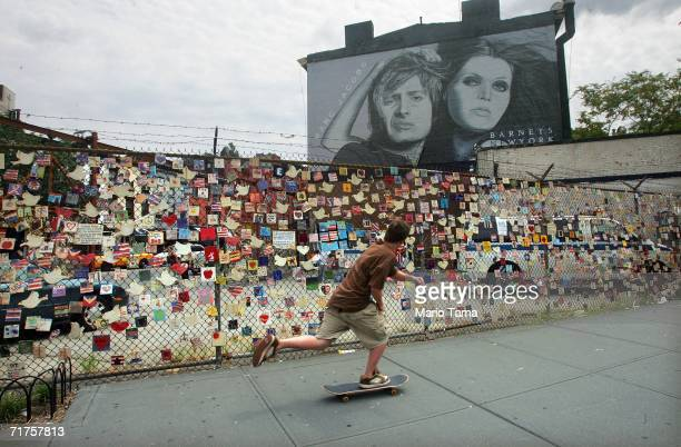 A teen skateboards past the Tiles for America installation across the street from St Vincent's Hospital August 18 2006 in New York City In the...