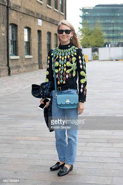 Teen Vogue Senior Fashion Market and Accessories Editor Jessica Minkoff wears a Love Moschino jacket Peter Pilotto top vintage jeans Gucci shoes Ray...