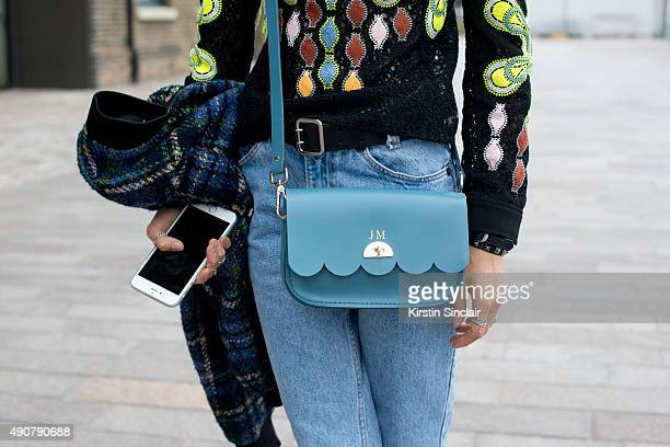 Teen Vogue Senior Fashion Market and Accessories Editor Jessica Minkoff wears a Love Moschino jacket Peter Pilotto top vintage jeans and a Cambridge...