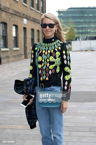 Teen Vogue Senior Fashion Market and Accessories Editor Jessica Minkoff wears a Love Moschino jacket Peter Pilotto top vintage jeans Ray Ban...