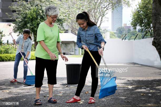 teen volunteering works - sweeping stock pictures, royalty-free photos & images