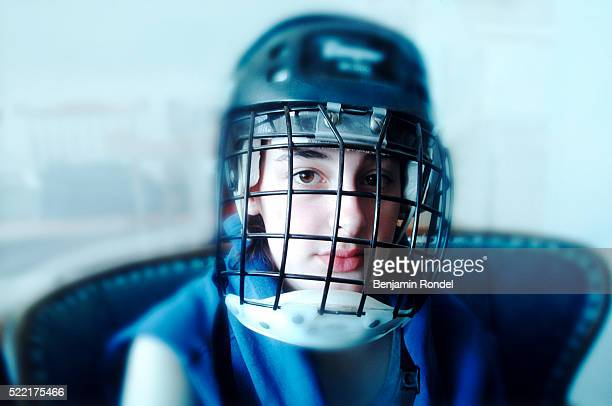 teen wearing helmet and face mask - ice hockey uniform stock pictures, royalty-free photos & images