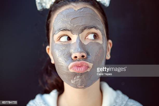 teen with chocolate facial beauty mask