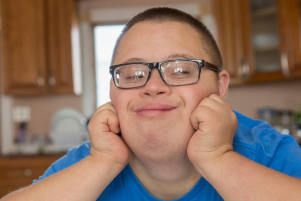 Teen with Down Syndrome studying