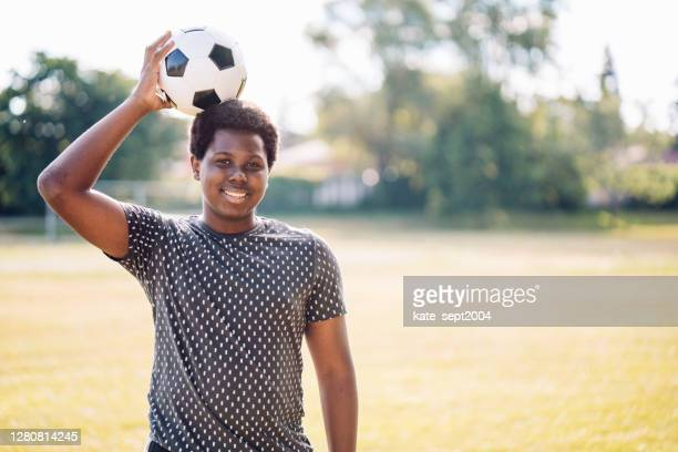 teen with soccer ball outdoor - afro caribbean ethnicity stock pictures, royalty-free photos & images