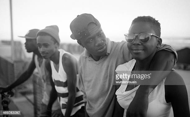 Teenage African American couple with friends