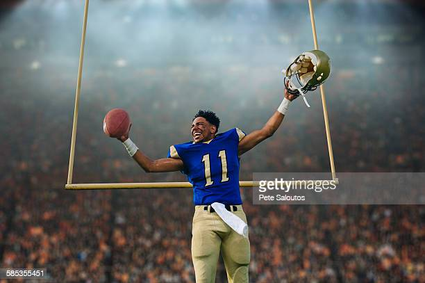 teenage american football player celebrating victory in soccer stadium - drive ball sports stock pictures, royalty-free photos & images