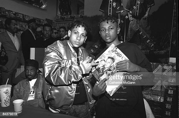 Teenage American rap duo Kriss Kross pose for a photo during a record signing in April 1998 in Paramus New Jersey On left in baseball cap is American...