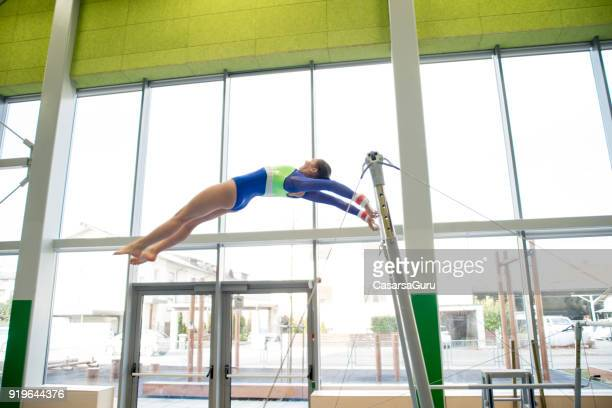 Teenage Athlete Excercising on Bars