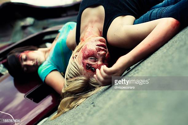 teenage automotive accident victims - dead female bodies stockfoto's en -beelden