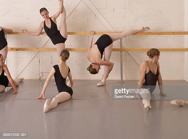 teenage ballerina girls (13-19) stretching - barre class stock photos and pictures