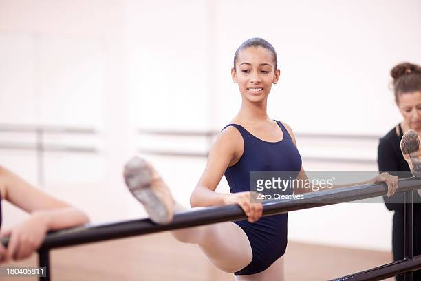 teenage ballerina practicing at the barre - teen girls in tights stock photos and pictures