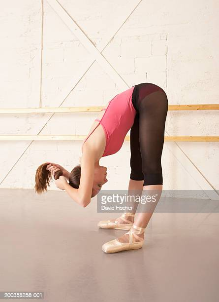 teenage ballerina (14-16) stretching and styling hair, side view - bending over stock pictures, royalty-free photos & images
