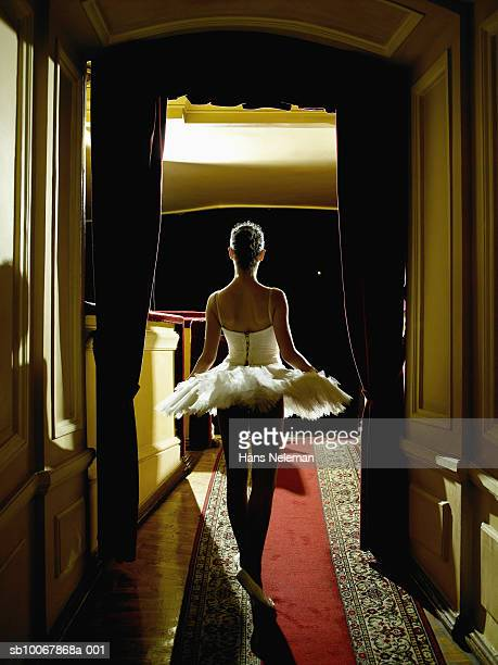 teenage ballerina (14-15) waiting in wings, rear view - backstage stock pictures, royalty-free photos & images