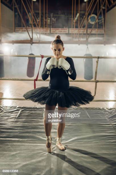 Teenage ballet dancer on a boxing training in a ring.