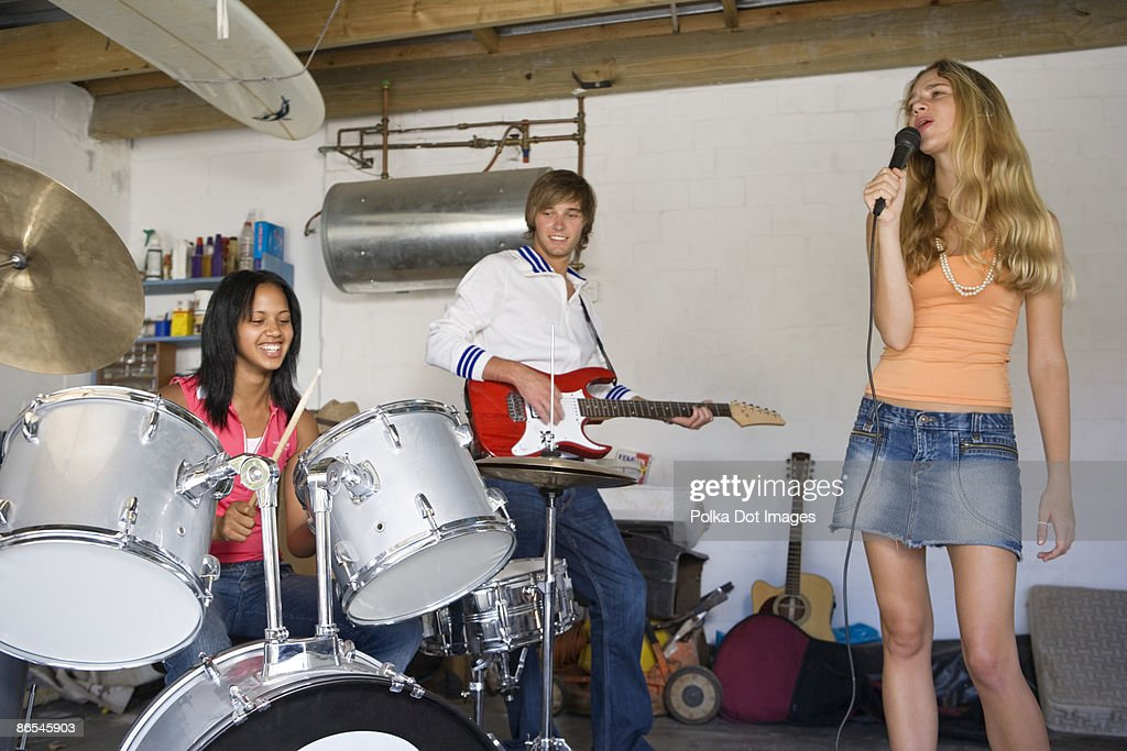 Teenage band in garage : Stock Photo