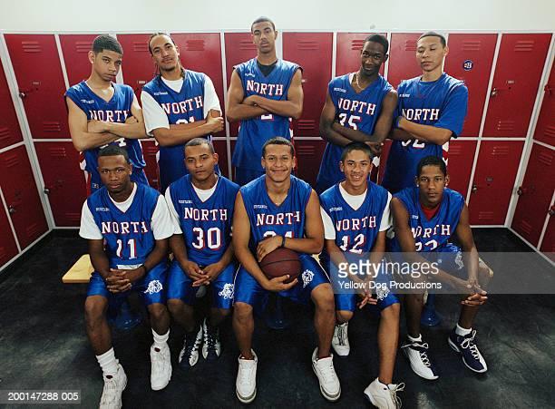 Teenage basketball players (16-18) in locker room, portrait