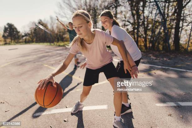 teenage basketball players - dribbling sports stock pictures, royalty-free photos & images