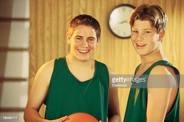 Teenage basketball players posing