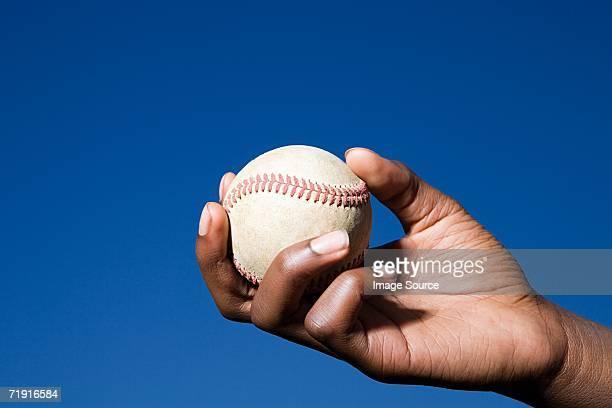 Teenage boy about to throw a baseball