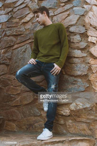 Teenage Boy Against Stone Wall