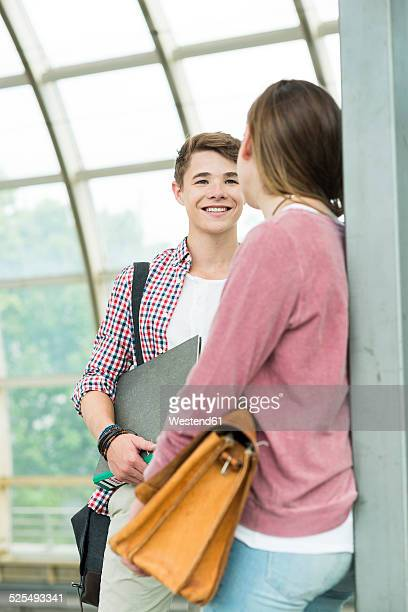 Teenage boy and girl at commuter train station