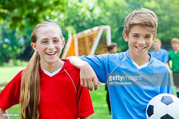 Teenage boy and girl have fun before soccer game