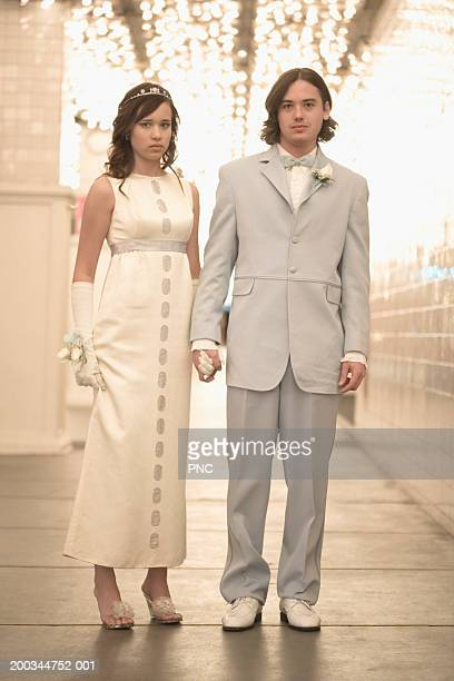 teenage boy and girl (14-16) in formalwear holding hands, portrait - white tuxedo stock pictures, royalty-free photos & images
