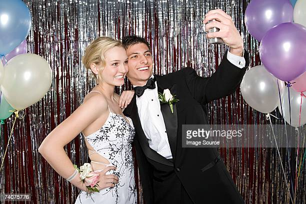 teenage boy and girl taking a picture at prom - prom stock pictures, royalty-free photos & images