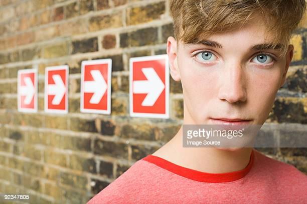 Teenage boy and row of arrows