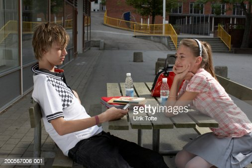 Number Names Worksheets table of 13 and 14 : Teenage Boy Sitting At Table Boy Using Mobile Phone Side View ...