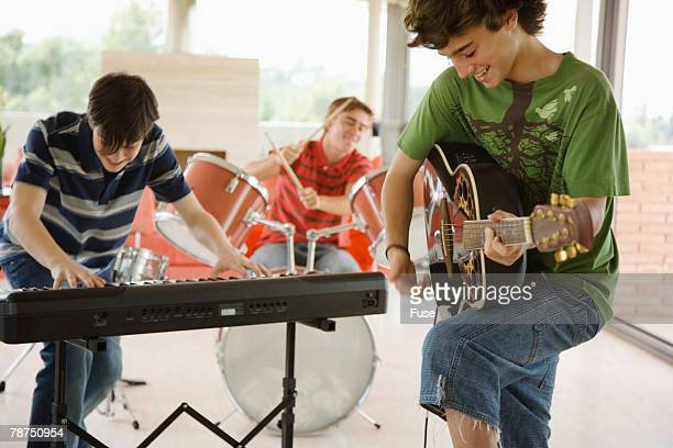 teenage boy band - rock band stock photos and pictures