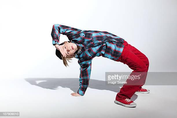 Teenage boy bending backwards