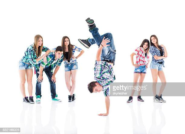 Teenage boy break dancing.