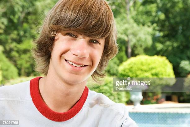 Teenage boy by pool