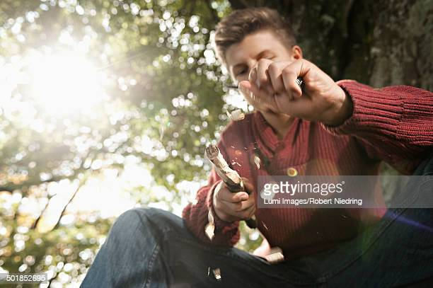 teenage boy carving wood, bavaria, germany, europe - carving knife stock pictures, royalty-free photos & images