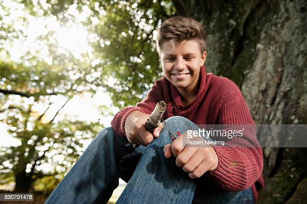 Teenage boy carving wood, Bavaria, Germany, Europe