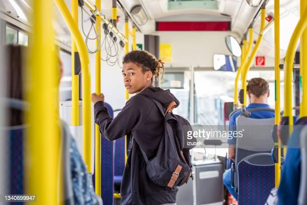 teenage boy commuting in bus - izusek stock pictures, royalty-free photos & images