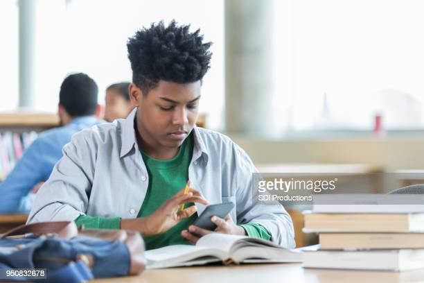 Teenage boy concentrates while studying