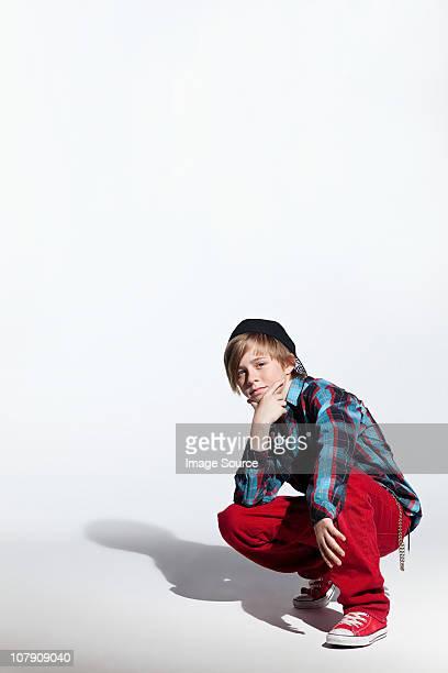 Teenage boy crouching