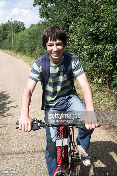 Teenage boy cycling in the countryside