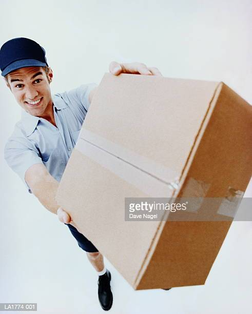 Teenage boy (17-19) delivering package, elevated view
