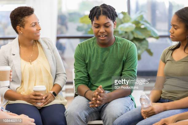 teenage boy discusses issues during support group - vulnerability stock pictures, royalty-free photos & images