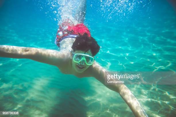 Teenage boy diving in the ocean