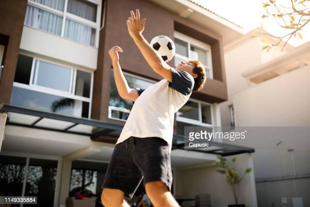 Teenage boy doing freestyle soccer tricks