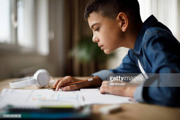 teenage boy doing homework - mathematics stock pictures, royalty-free photos & images