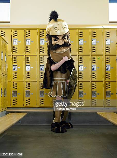 Teenage boy (15-17) dressed as mascot, in locker room, portrait