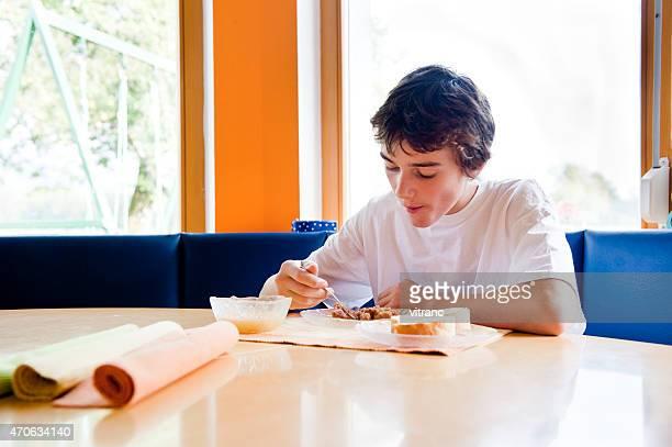 Teenage Boy  Eating Breakfast