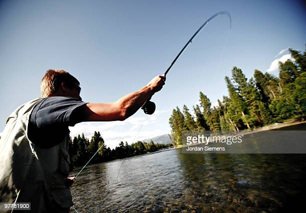 a teenage boy fly fishing in swan river near bigfork, montana. - fly casting stock pictures, royalty-free photos & images